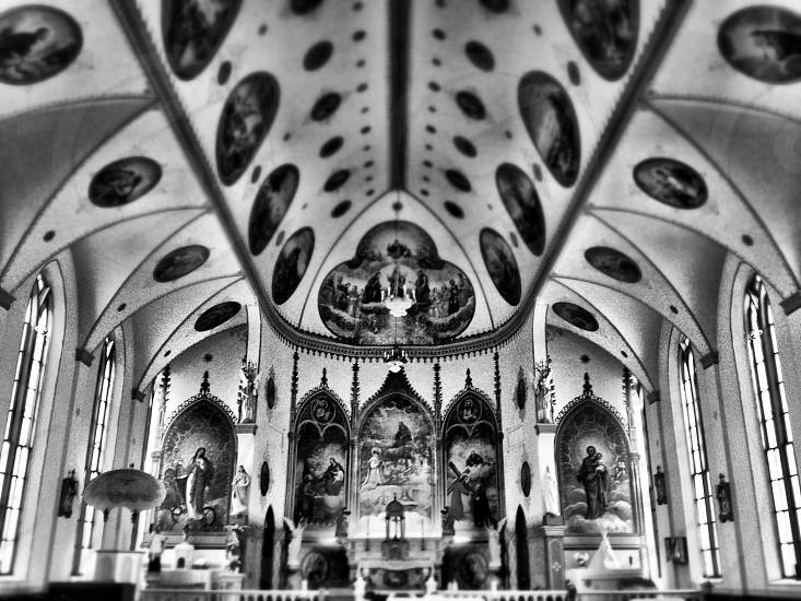 Church Catholic interior ornate religious black and white symmetrical symmetry priest photo