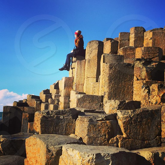 Girl atop a rock formation in Northern Ireland photo