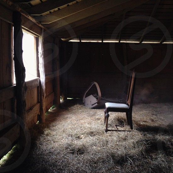 grey padded brown wooden chair in the barn photo