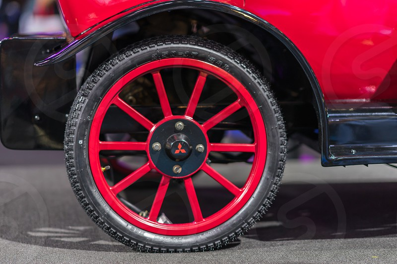Red wheel on a vintage car. photo
