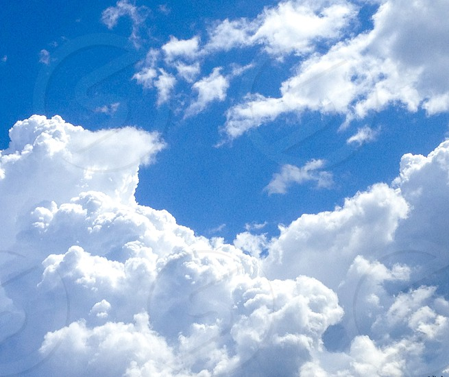 Clouds Sky heaven breeze blue white puff afternoon photo