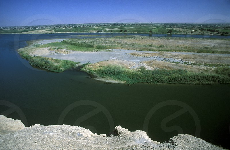 the euphrates river near the city of Deir ez zur in the east of Syria in the middle east photo