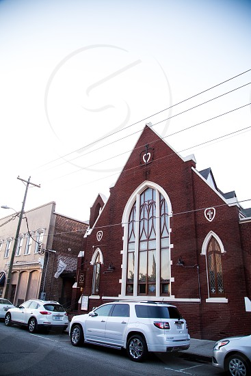 Exterior of 5Church in an actual church space with stained glass windows. photo