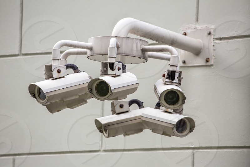 CCTV cameras on the wall looking in different angles photo