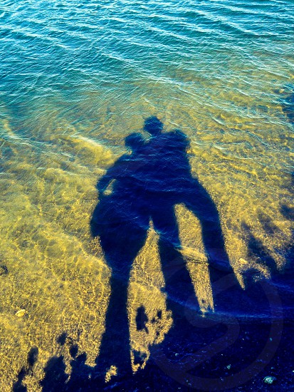 Shadow of the couple on the water photo