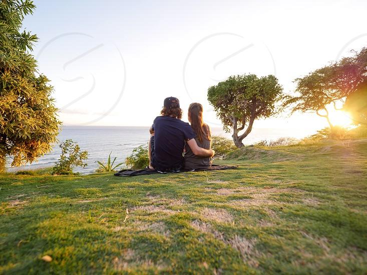 Couple enjoying the sunset during golden hour romance  photo