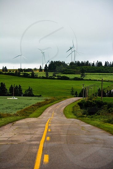 Windmills at the end of the road in PEI photo