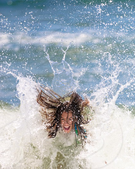 A girl plays in the surf at a Florida beach. photo