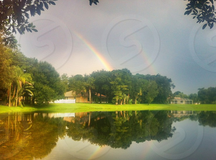 double rainbow storm reflection lake florida photo