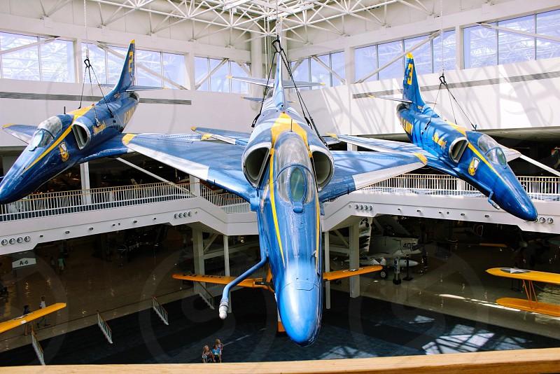yellow blue and white airplane photo
