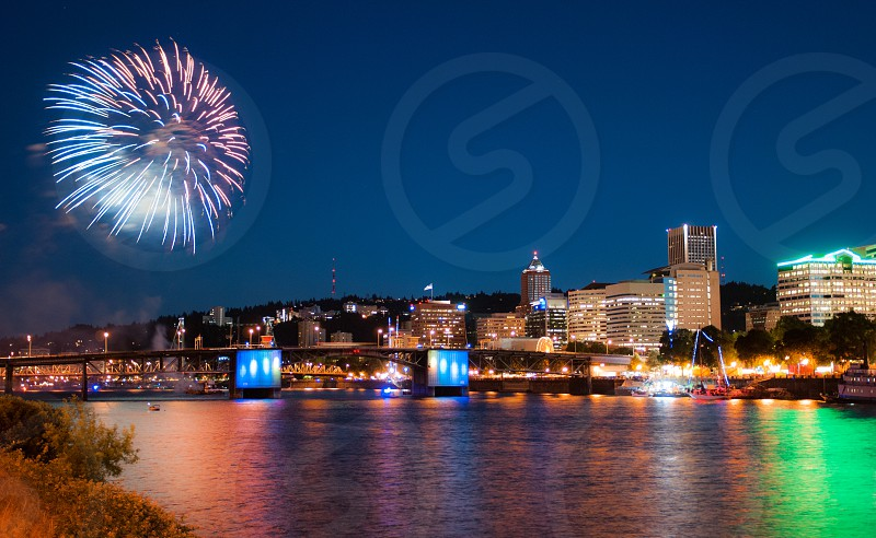 The Portland Oregon waterfront during the annual Rose Festival fireworks show. photo