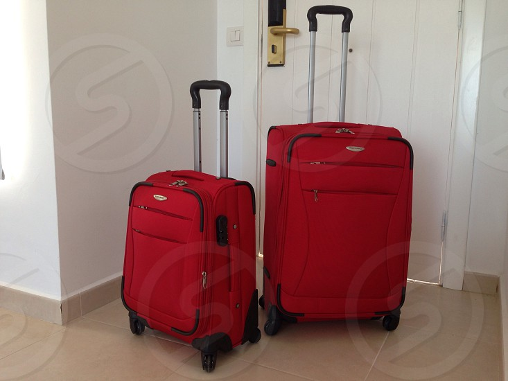 red travelling bag photo