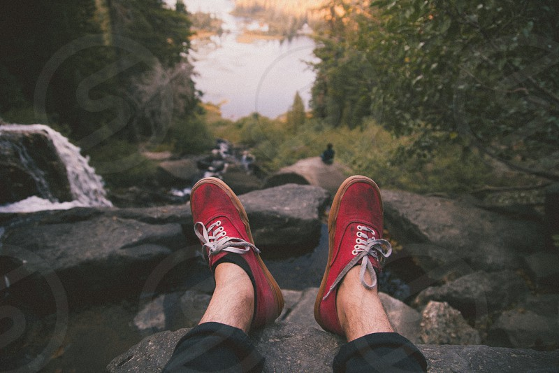 red and white lace up sneakers on rock photo