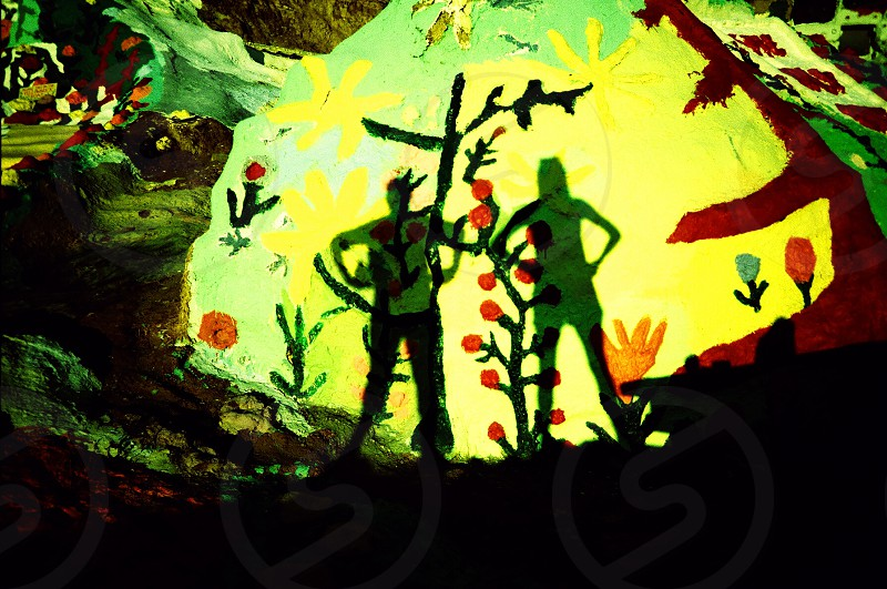 man and woman silhouette painting with black tree photo