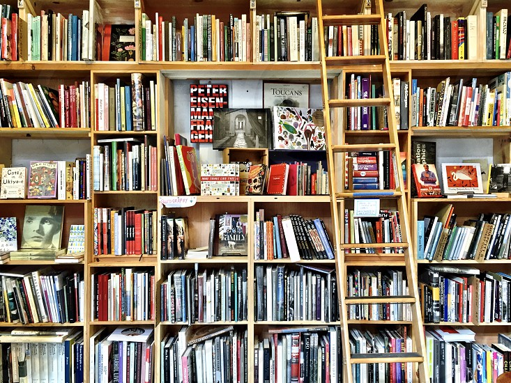 Bookstore shelves by Julie Gebhardt. Photo stock - Snapwire