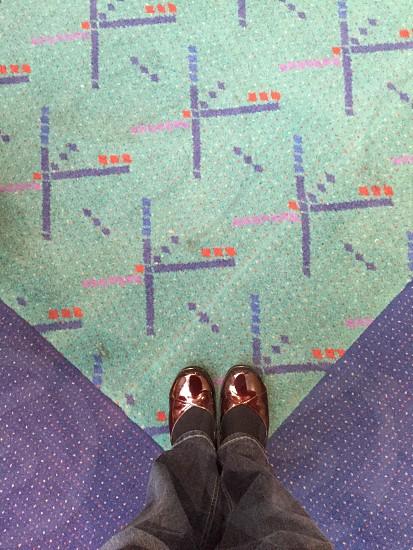 Portland Oregon International Airport carpet feet red shoes photo