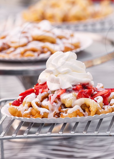 Funnel cake with whipped cream photo