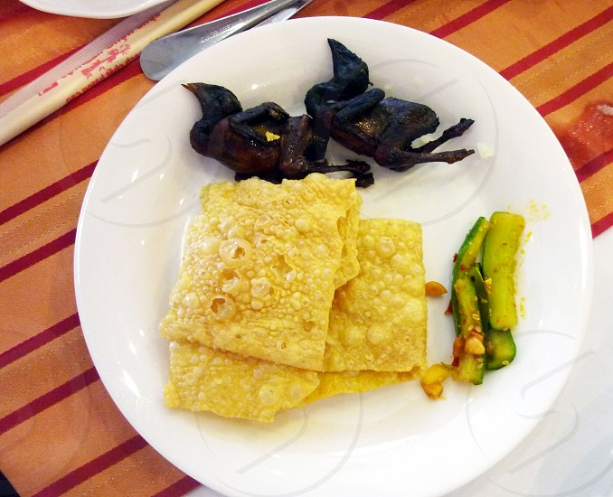 egg omelet with fried bird on round ceramic plate photo