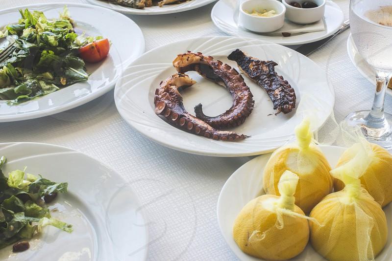 Octopus in a Greek restaurant. White table. Greece Athens Piraeus photo