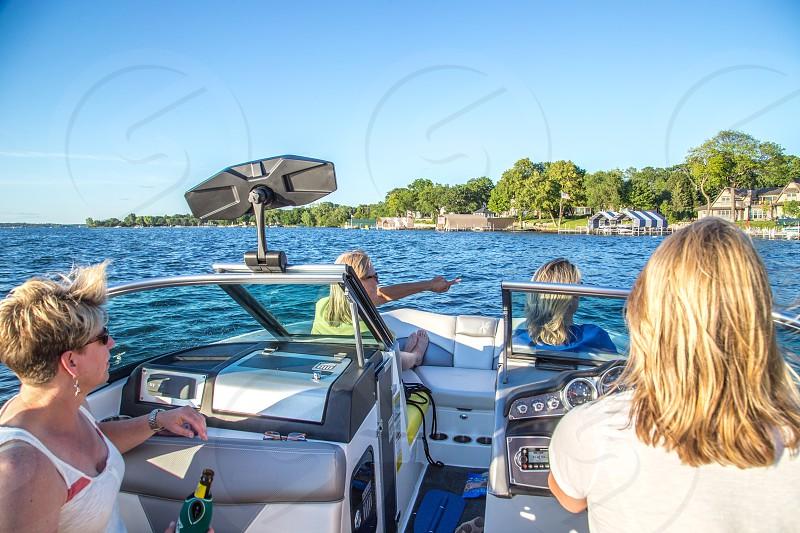 Ladies riding speedboat on the lake photo