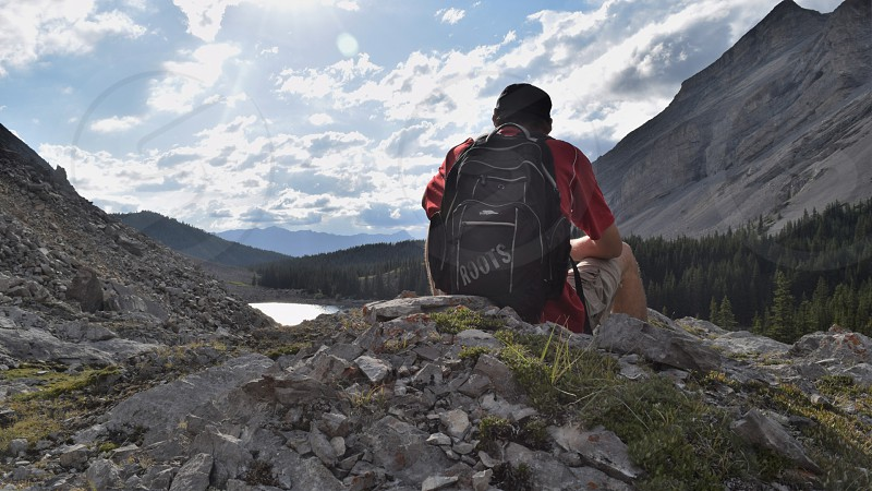 A hiker rests after a long hike into a beautiful secluded area photo