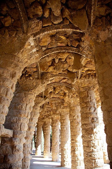 Arcade of masonry stone columns in Park Guell Barcelona of Gaudi modernism photo
