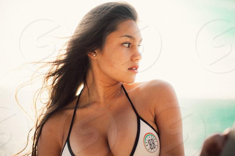 woman with black hair wearing bikini photo
