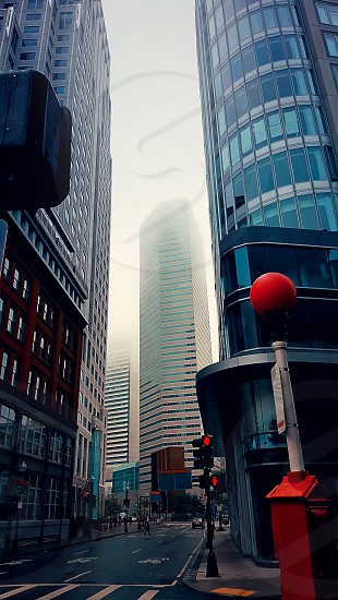 Foggy morning on a street through skyscrapers photo