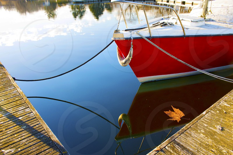 reflections on the water of a sailing boat on the lake photo