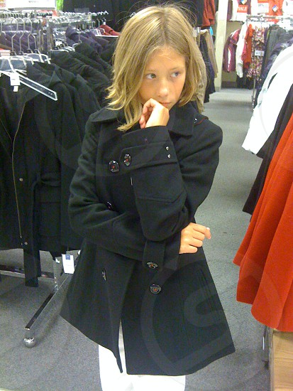 My daughter jacket shopping. photo