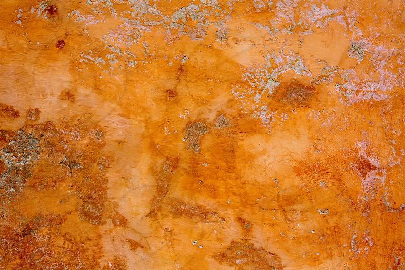 Ibiza grunge orange facade texture cement background photo