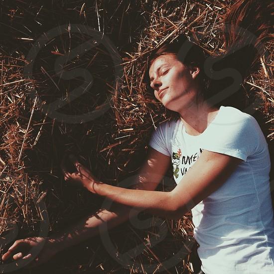 Girl sleeping in the field photo