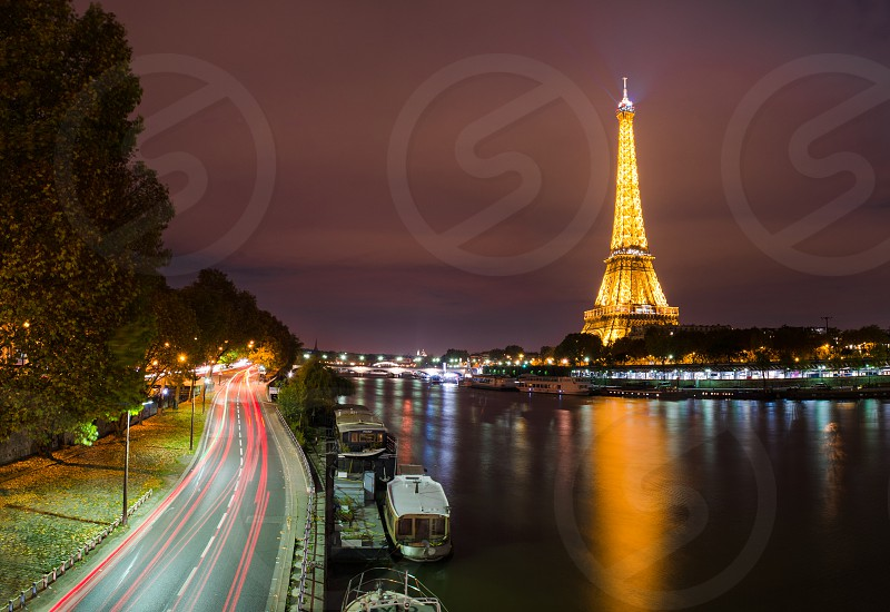 The Eiffel Tower and La Seine at night in Paris photo