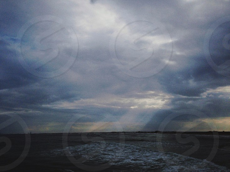cloudy skies over the sea photo