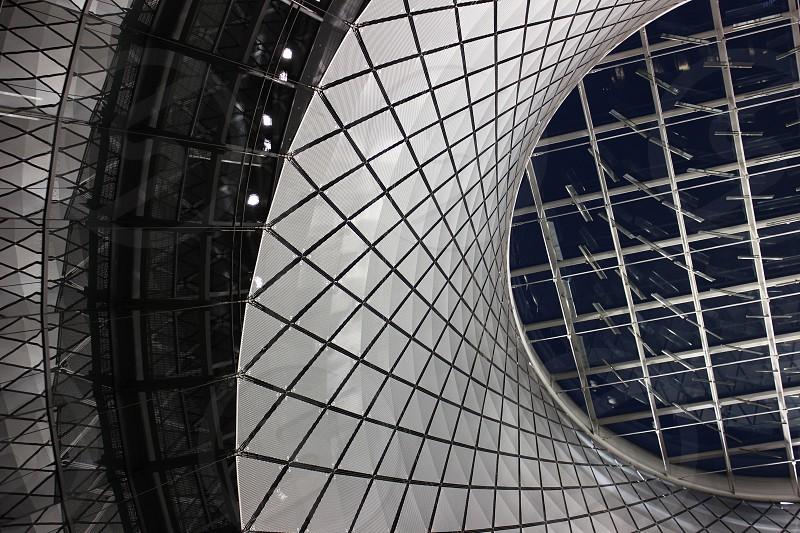 grey metal framed spiral building photo
