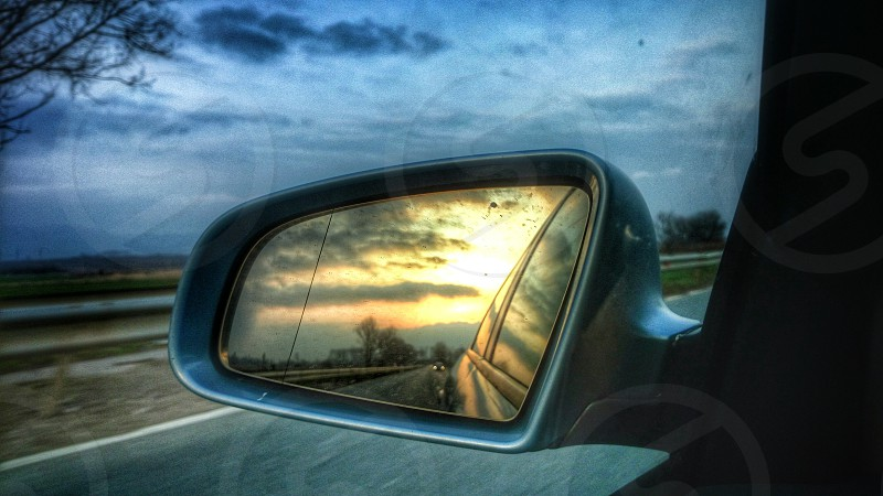 travel on the road side mirror sunset highway photo