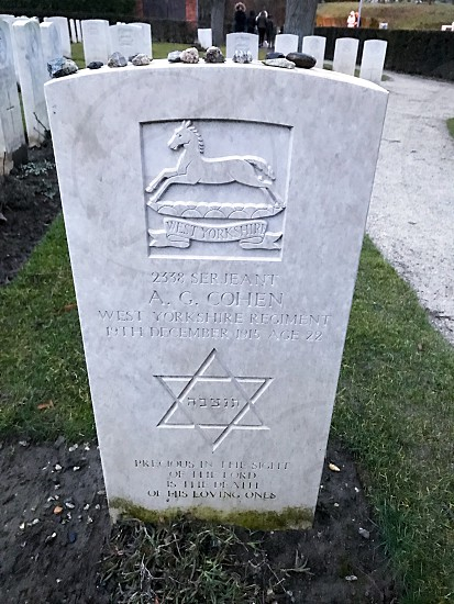 Outdoor day vertical portrait colour Essex Farm Cemetery Allied British Commonwealth graveyard graves gravestones memorial War remembrance white marble stone carved grass fields poppies countryside Ypres salient Europe European fields sky nature rest peace beauty silence wreath respect Jewish Judaism Star of David stones religion  photo
