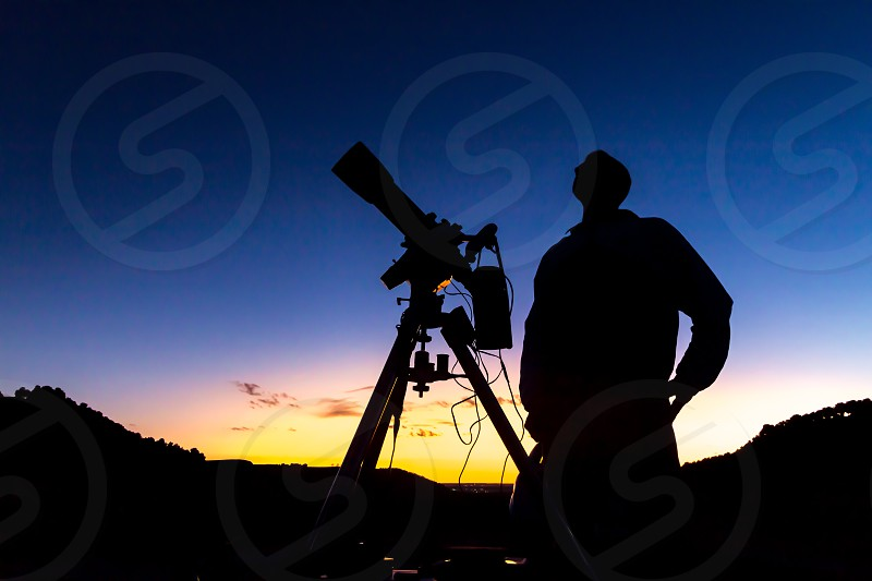 An astronomer observing the sky. photo