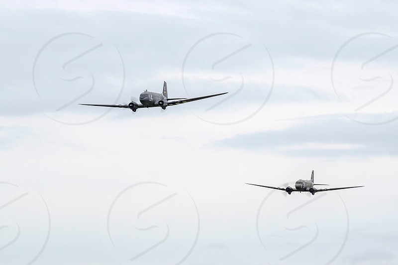 Two Douglas C-47 Skytrains  flying over Shoreham Airfield photo