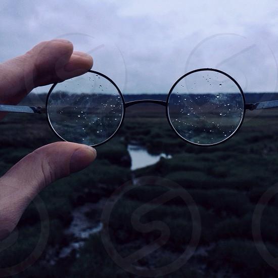 black framed eyeglasses on hand photo