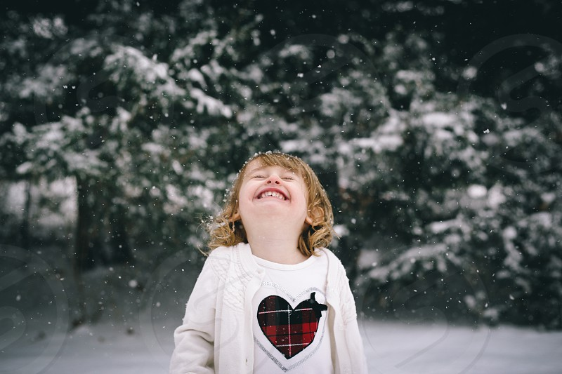 girl's white heart printed shirt photo