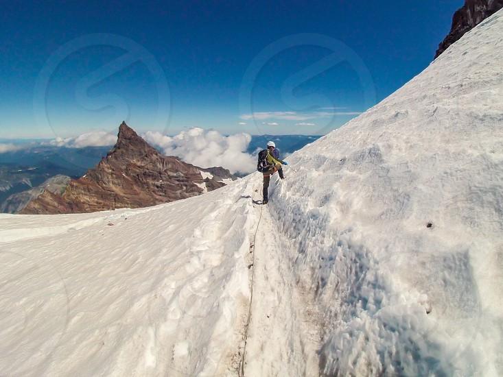 Snowmountainhikegearclimberhikerwinterrainiermountaintopmountain climberice axetetheredcrampons photo