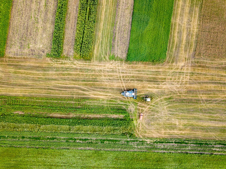 Cultivation of the agricultural field after harvesting. Preparation of soil for sowing of winter crops. Aerial view from the drone of the field after harvest. photo