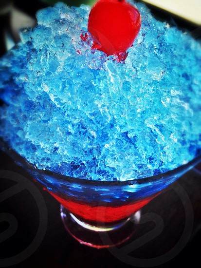 lomo and close up photography of red beverage covered with crushed ice and topped with cherry photo
