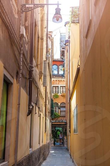 Venice Italian Destination. Narrow Venetian Pathway. Quaint street in historic Venice. photo
