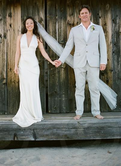 Beach wedding Malibu California destination wedding coast bride groom white photo