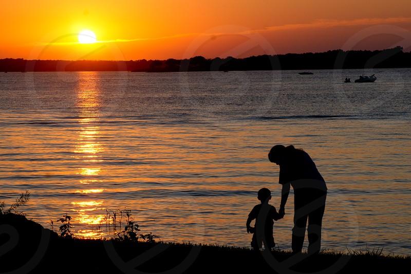 sunset by lake photo