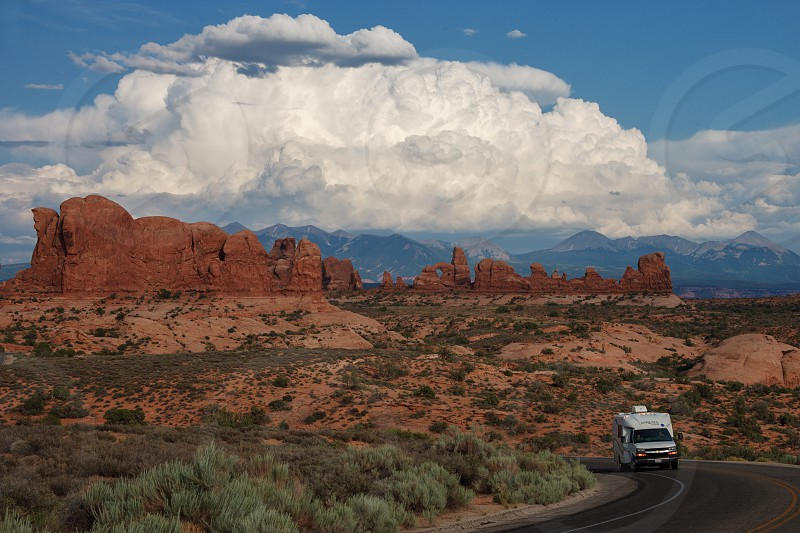 Thunderhead looms over the Windows Section of Arches National Park Moab Utah USA photo
