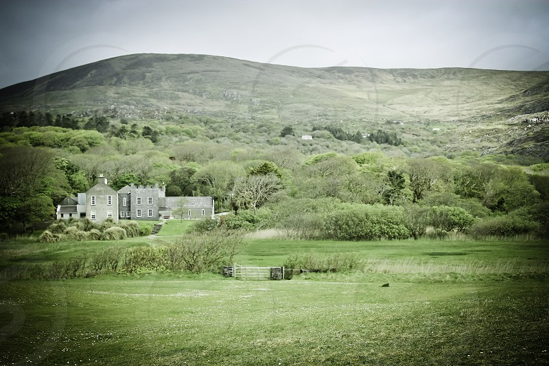 Irish landscape image featuring an old castle. photo