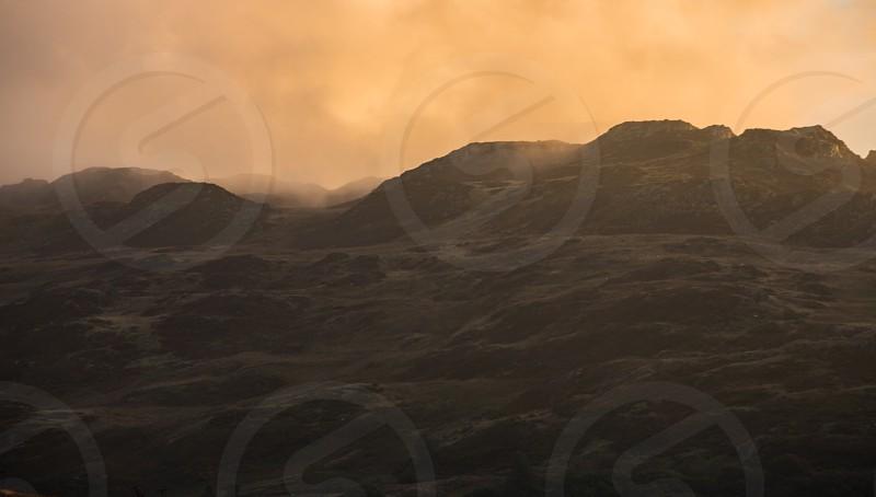 Dark and moody landscape with barren terrain photo
